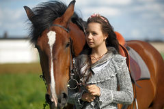 Teen girl with the brown horse Stock Photo