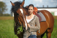 Teen girl with the brown horse Royalty Free Stock Photo