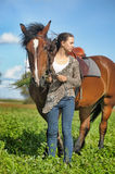 Teen girl with the brown horse Stock Images