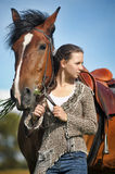 Teen girl with the brown horse Stock Photography