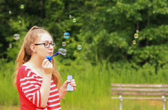 Teen girl-bubbles all around Royalty Free Stock Photo