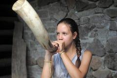 Teen girl buzzing horn Stock Images