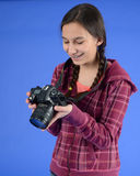 Teen girl with camera. Teen photographer looking at camera Stock Photography