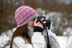 Teen girl with camera in hands Royalty Free Stock Images