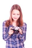 Teen girl with camera Royalty Free Stock Photos