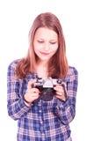 Teen girl with camera Royalty Free Stock Photos