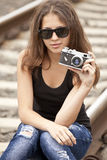 Teen girl with camera at railways. Stock Photography