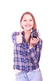 Teen girl with camera showing like Royalty Free Stock Images