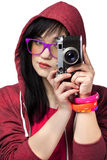 Teen girl with camera at white background. Royalty Free Stock Photos
