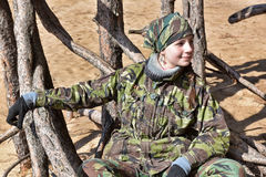 Teen girl in camouflage clothes Stock Images