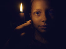 Teen girl with a candle Stock Photos