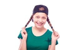 Teen girl in cap having fun Stock Photos