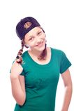 Teen girl in cap having fun Royalty Free Stock Photography