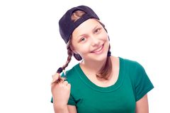 Teen girl in cap having fun Stock Photo