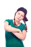 Teen girl in cap posing Royalty Free Stock Image
