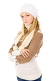 Teen girl in a cap and scarf Stock Photos