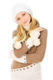 Teen girl in a cap and scarf isolated Royalty Free Stock Image