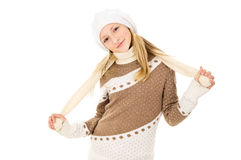 Teen girl in a cap and scarf Royalty Free Stock Images