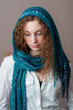 Teen girl in casual clothing wearing a headscarf. Pretty caucasian teenage girl wearing a beautiful blue headscarf Stock Image