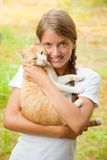 Teen girl with  cat. Teen girl with her cat smiling outdoors Stock Photo