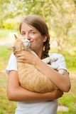 Teen girl with  cat. Teen girl with her cat smiling outdoors Royalty Free Stock Images