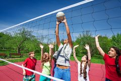 Teen girl catches the ball during volleyball game Stock Photography