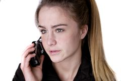 Teen girl on cell phone demure.jpg. Blonde teen on phone looking concerned Stock Photography