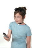 Teen Girl With Cellphone 1a. Cute tween or young teenage girl standing up and talking on a cellphone; shot on white Royalty Free Stock Photography