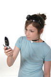 Teen Girl With Cellphone 2a. Cute tween or young teenage girl standing up and talking on a cellphone; shot on white Stock Image