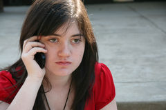 Teen girl on cellphone royalty free stock image