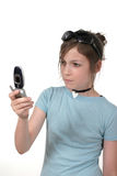Teen Girl With Cellphone 3a. Cute tween or young teenage girl with sunglasses on her head standing up and talking on a cellphone; shot on white stock photos