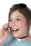Teen Girl With Cellphone 5a. Cute tween or young teenage girl wearing sunglasses on her head, standing, and talking on a cellphone; shot on white royalty free stock photos