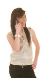 Teen girl on cellphone Stock Images