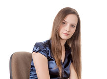 Teen girl on chair Royalty Free Stock Photos