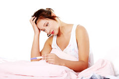 Teen girl checking pregnant test. Royalty Free Stock Photos