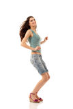 Teen girl cheerful dancing Royalty Free Stock Image