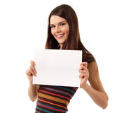 Teen girl cheerful holding blank white paper Royalty Free Stock Images