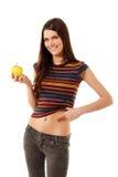 Teen girl cheerful slim with apple Stock Photo