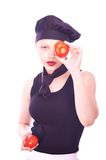 Teen girl in chef hat with tomatoes Royalty Free Stock Image