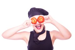 Teen girl in chef hat with tomatoes Stock Photos