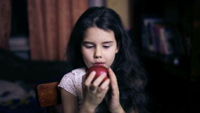 Teen girl child eating an apple bites a healthy stock footage