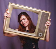 Teen girl child framed television smiling on gray Royalty Free Stock Photography
