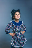 Teen girl child in a plaid dress and men's hat Stock Images