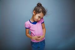 Teen girl child stomach ache on  gray background Royalty Free Stock Photo