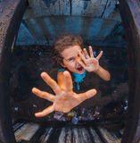 Teen girl child zombie demon pulls his hands up Stock Image