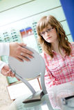 Teen girl choose an glasses Royalty Free Stock Image