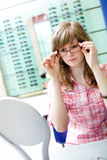 Teen girl choose an glasses Stock Photos