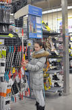 Teen girl chooses a bow for shooting sports shop Royalty Free Stock Images