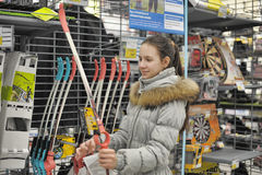 Teen girl chooses a bow for shooting sports shop Stock Photography