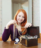 Teen girl chooses jewelry Royalty Free Stock Photo